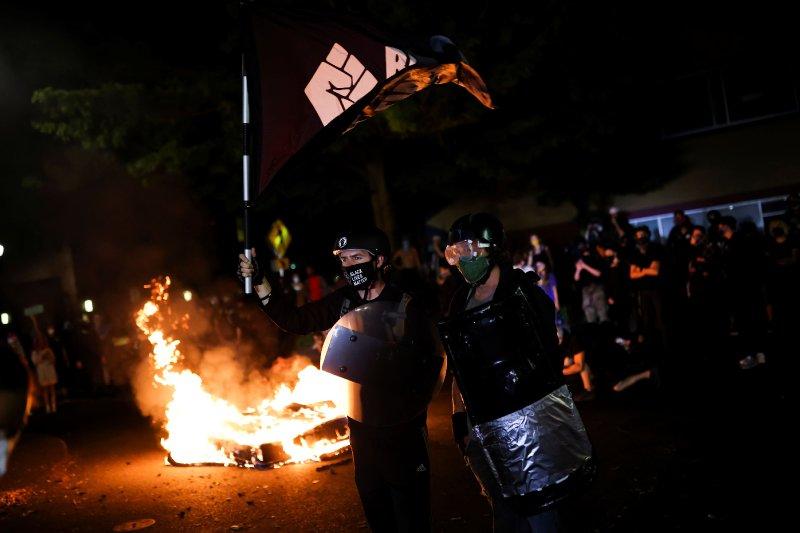 Police arrest 15 more after overnight protests in Portland