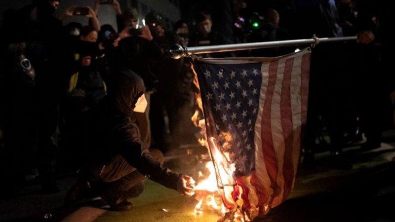 Portland police arrest 100 protesters
