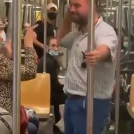 Trumpster F***head harasses old woman on New York City subway
