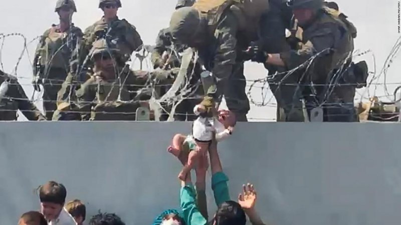 Fact check: Did the Marine who Trump brought on stage at rally actually hoist a baby over a wall at Kabul airport? - CNNPolitics