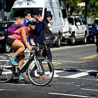 urban-life-new-york-city-female-bicyclist-at-manhattan-intersection-picture-id501478138.jpeg