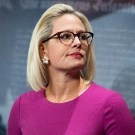 Kyrsten Sinema is reportedly threatening to hold Biden's agenda hostage. She wants to pass the bipartisan roads-and-bridges bill now.