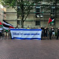 NEO-NAZIS WAVE PALESTINIAN FLAGS IN PROTEST AGAINST ISRAEL