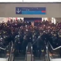 Hundreds of migrants occupy France's Charles de Gaulle airport, demand to meet the Prime Minister and call for an end to deportations