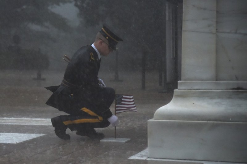 Thestreets flooded. Trees as old as the cemetery itself broke at the trunk and came crashing down. But America's Regiment endured.