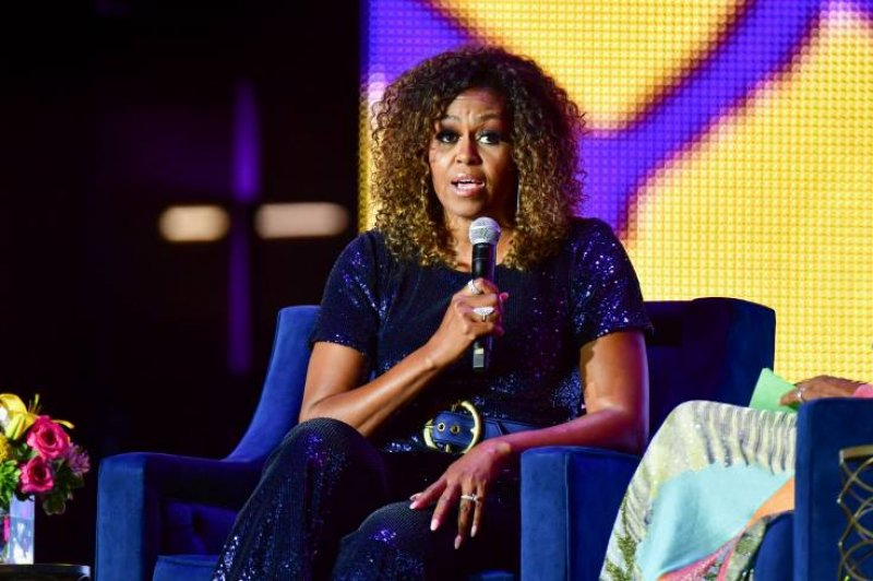 Michael Moore : Michelle Obama Would Crush Trump In The Election