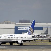 Two United Airlines pilots arrested before flight from Scotland to U.S.