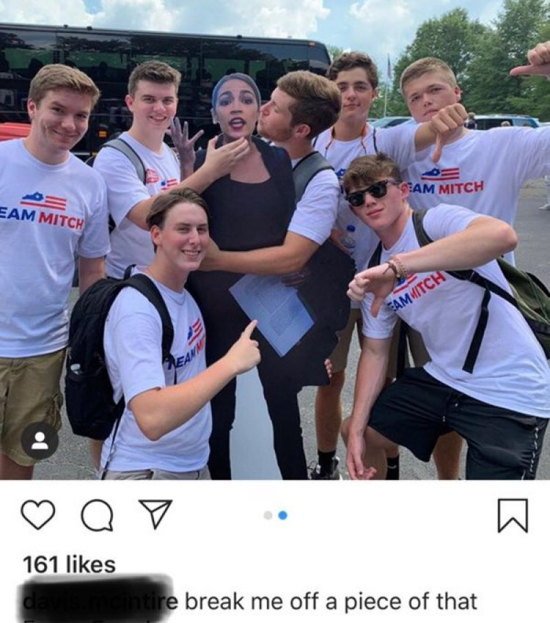Smiling 'Team Mitch' Supporters Pose While Choking Cutout Of Alexandria Ocasio-Cortez