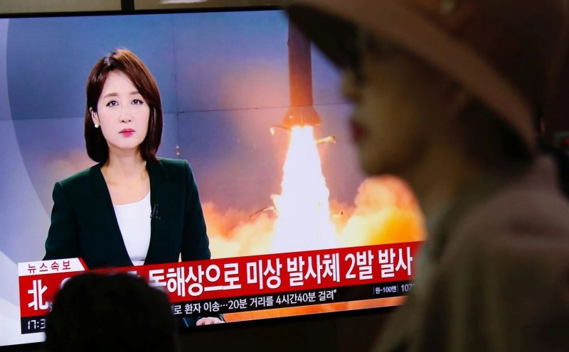 North Korea fires two missiles after warning it is losing patience with the U.S.