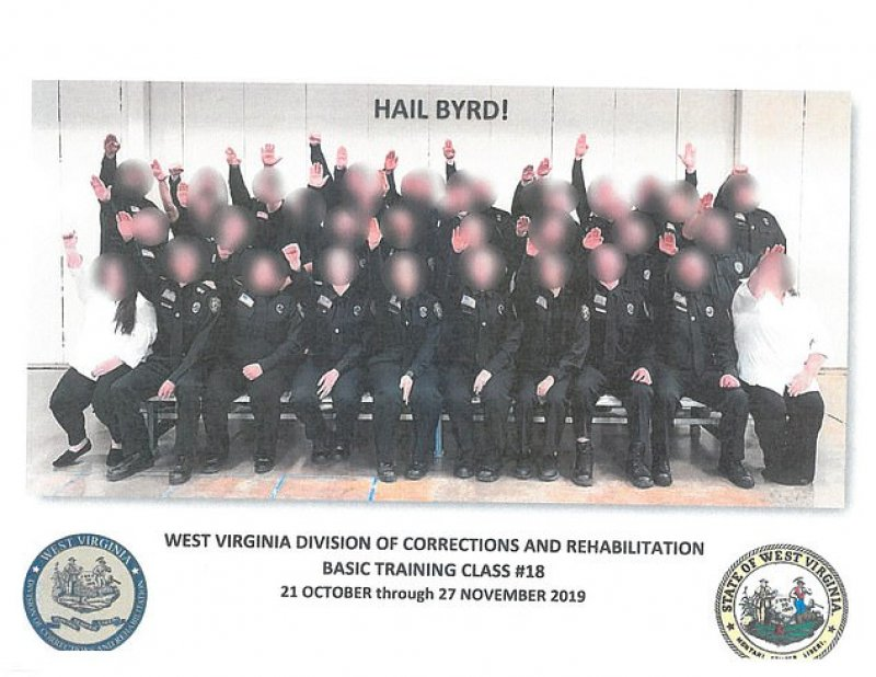 West Virginia prison employees are suspended after guard trainees are photographed doing Nazi salutes in their official group photo