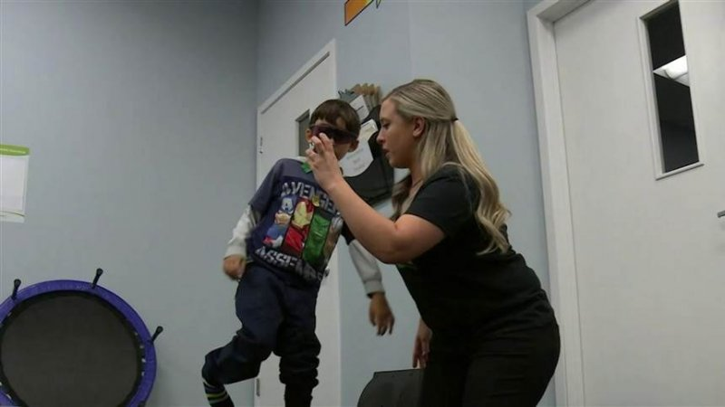 Parents pay thousands for 'brain training' to help kids with ADHD and autism. But does it work?