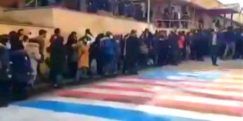 Iran protests: Crowds in Tehran refuse to walk on U.S. and Israeli flags