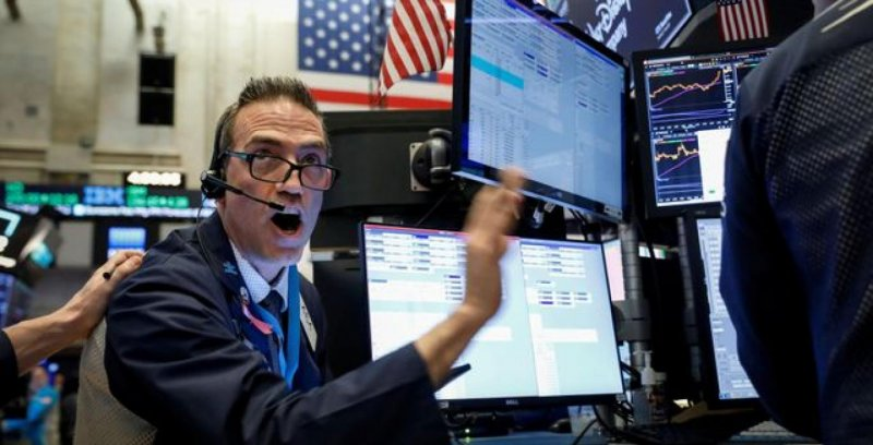 Wall Street tumbles after Fed surprise rate cut