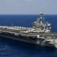 Commander of aircraft carrier hit by coronavirus removed for 'poor judgment' after sounding alarm