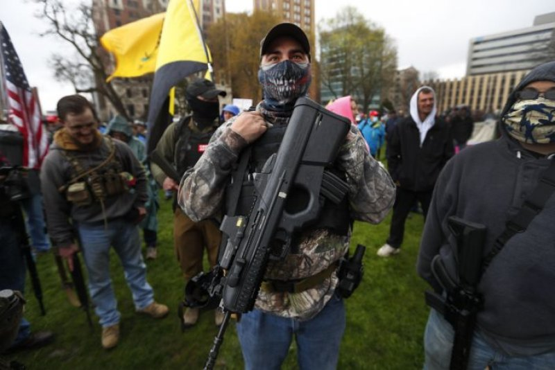 Armed protesters in Michigan foreshadow a tense election season in key swing state