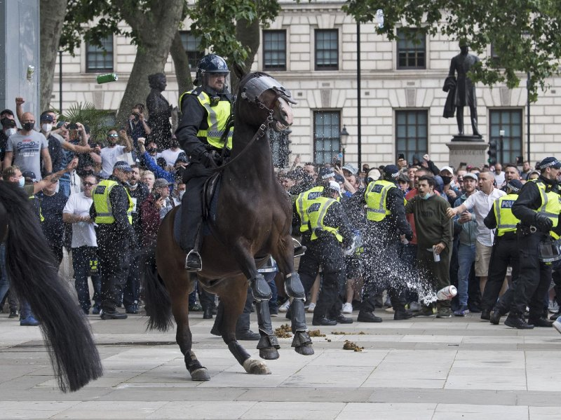 London protests: Johnson condemns 'racist thuggery' after far right demonstrators clash with police outside parliament