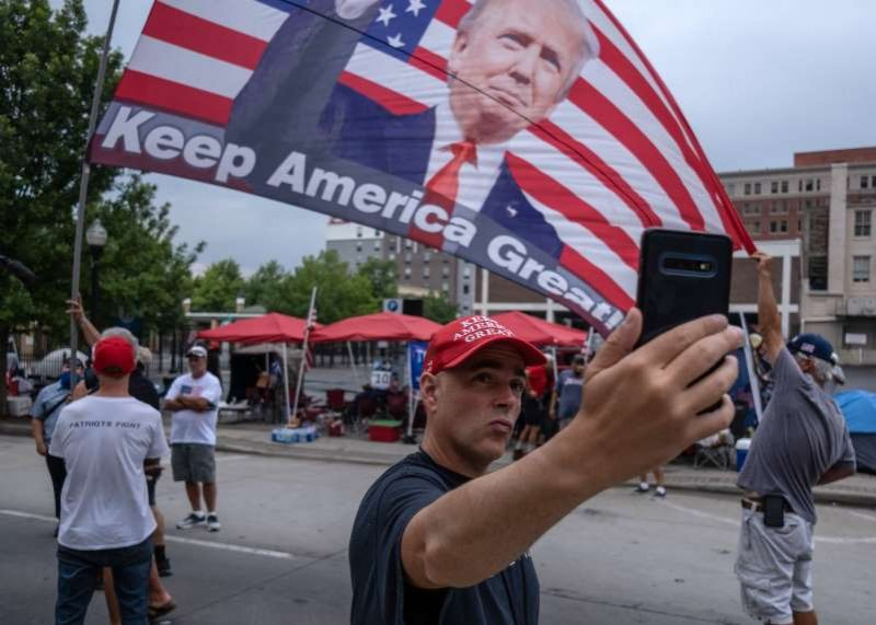 Outside Trump's Tulsa rally site, few face masks and no social distancing