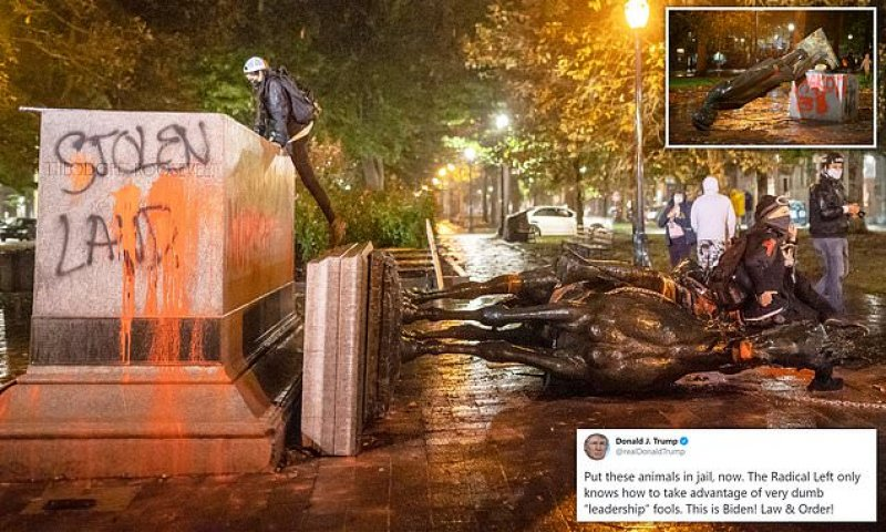 Statues of Abraham Lincoln and Theodore Roosevelt toppled in Portland | Daily Mail Online