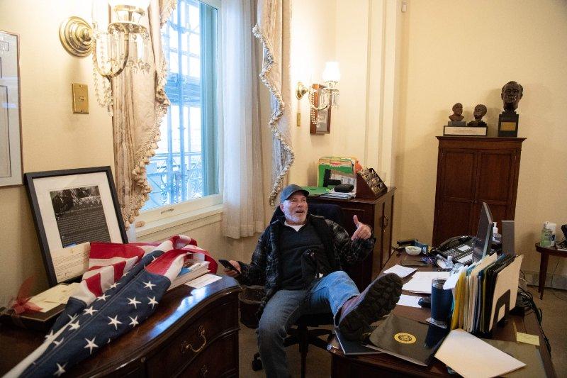 Richard Barnett, Man Seen Sitting at Nancy Pelosi's Desk, Arrested in Arkansas