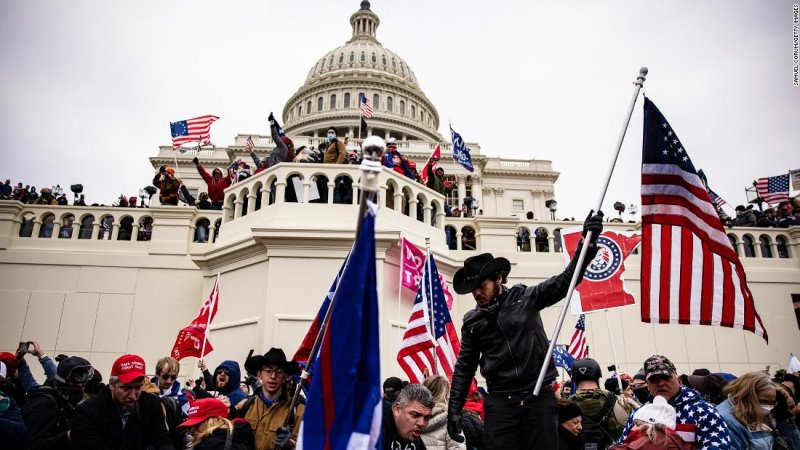 Decoding the extremist symbols and groups at the Capitol Hill insurrection  - CNN
