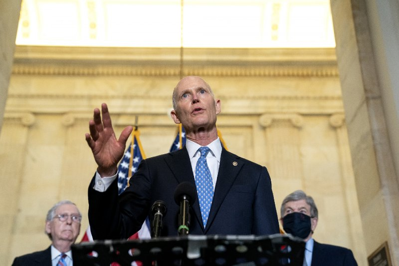 Rick Scott Ripped After Saying He Gave Trump 'Freedom' Trophy Because 'He Worked Hard'