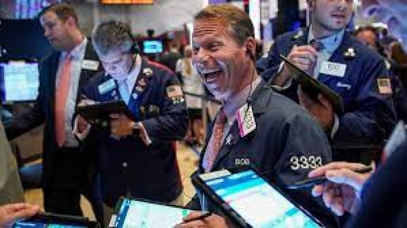 The three major stock market indexes closed at new record highs Monday
