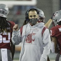Washington State fires football coach for refusing COVID vaccine