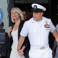 U.S. Navy SEAL demoted for posing with dead prisoner