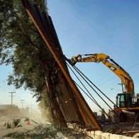 Parts of a new California border fence weren't yet anchored. Big winds blew them down